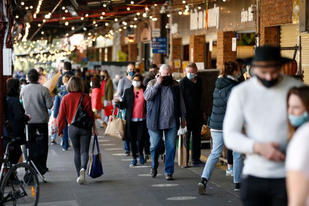 Large crowds of people are seen shopping at South Melbourne Market on August 02, 2020 in Melbourne,