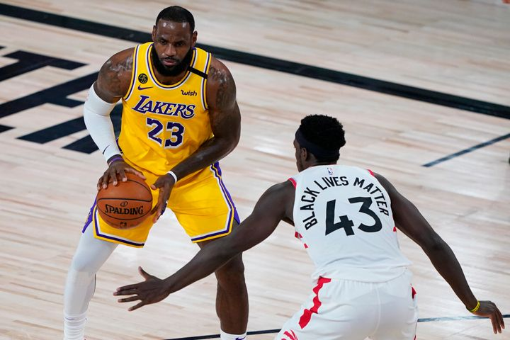 LeBron James, left, faces off against Pascal Siakam during a game on Saturday night.