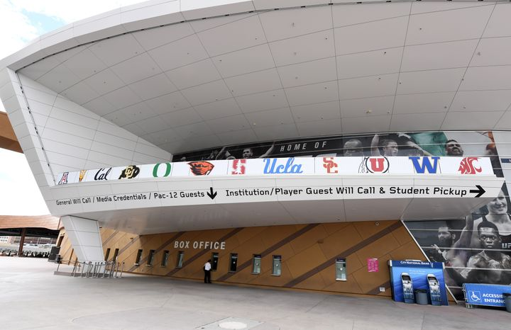 Logos of schools that were scheduled to participate in the canceled PAC-12 men's basketball tournament adorn the T-Mobile Are