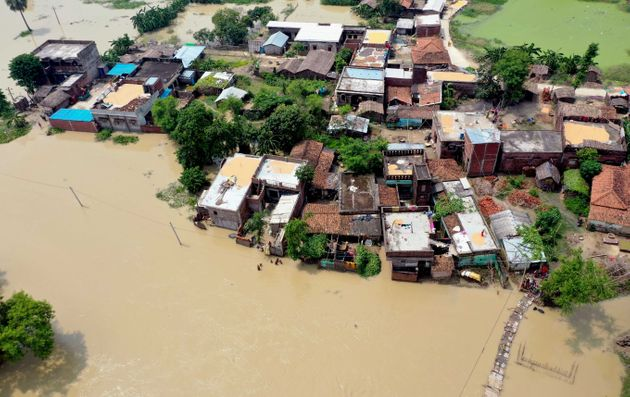 A photo taken on July 26, 2020 shows an aerial view of a flood-affected village in Darbhanga district...
