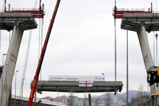 GENOA, ITALY - FEBRUARY 09: The first section of the remains of the Morandi Bridge is being taken down...