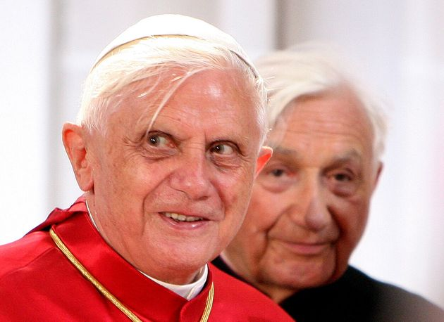 Pope Benedict XVI and his brother Georg Ratzinger (R) stand in the baptistry where they were baptised,...