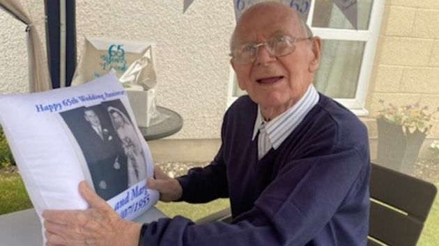 Couple Celebrate 65th Wedding Anniversary Physically-Distanced With Whisky And Cuddle Cushions