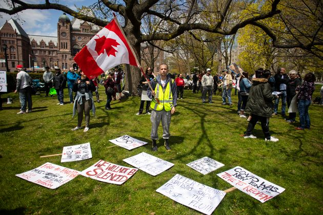 Protesters gather outside the Ontario Legislature in Toronto, as they demonstrate against numerous issues...