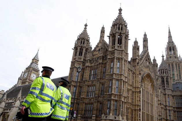 Police officers outside the Houses of Parliament. A Conservative MP has been arrested on suspicion of
