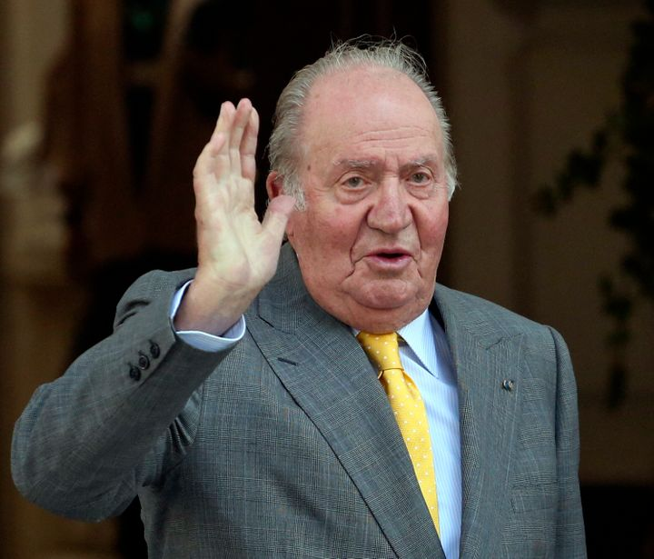 In this March 10, 2018, file photo, Spain's former monarch King Juan Carlos waves upon his arrival to the Academia Diplomatic