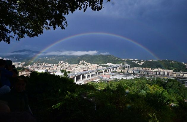 TOPSHOT - A rainbow is seen over the new San Giorgio bridge on the inauguration day on August 3 , 2020...