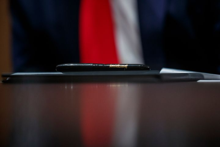 A pen to be used by President Donald Trump rests upon an executive order during a meeting with U.S. tech workers Monday at th