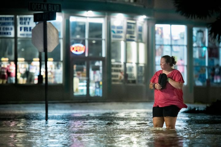 A woman walks through floodwaters on Ocean Boulevard in Myrtle Beach, South Carolina on Monday.