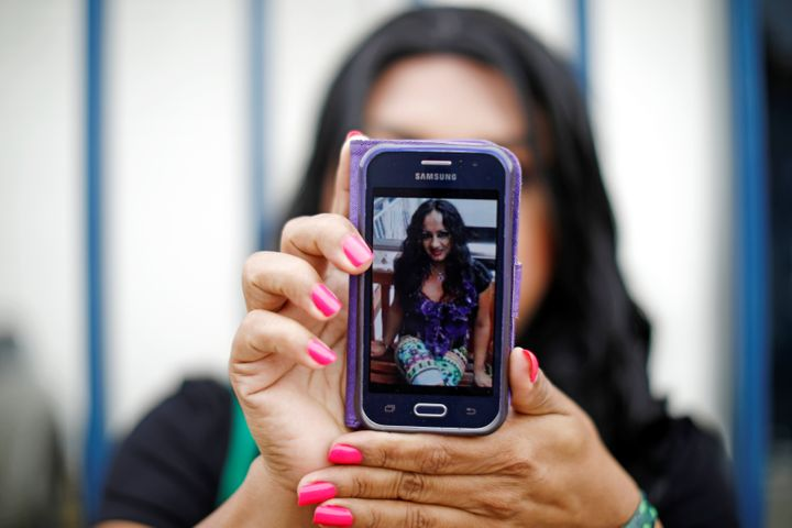 A friend in El Salvador shows a picture of Camila Diaz Cordova, a trans woman killed in that country where she returned after