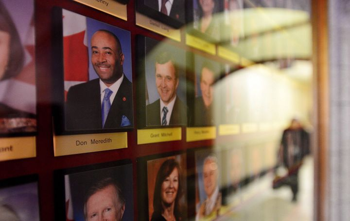 A portrait of Senator Don Meredith is displayed on the wall alongside fellow senators on Parliament Hill in Ottawa on May 9, 2017.