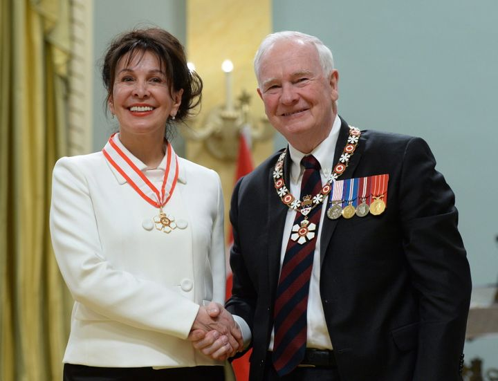 Louise Otis of Montreal, Que., gets invested as an Officer of the Order of Canada by former governor general David Johnston during a ceremony at Rideau Hall in Ottawa on Feb. 12, 2016.