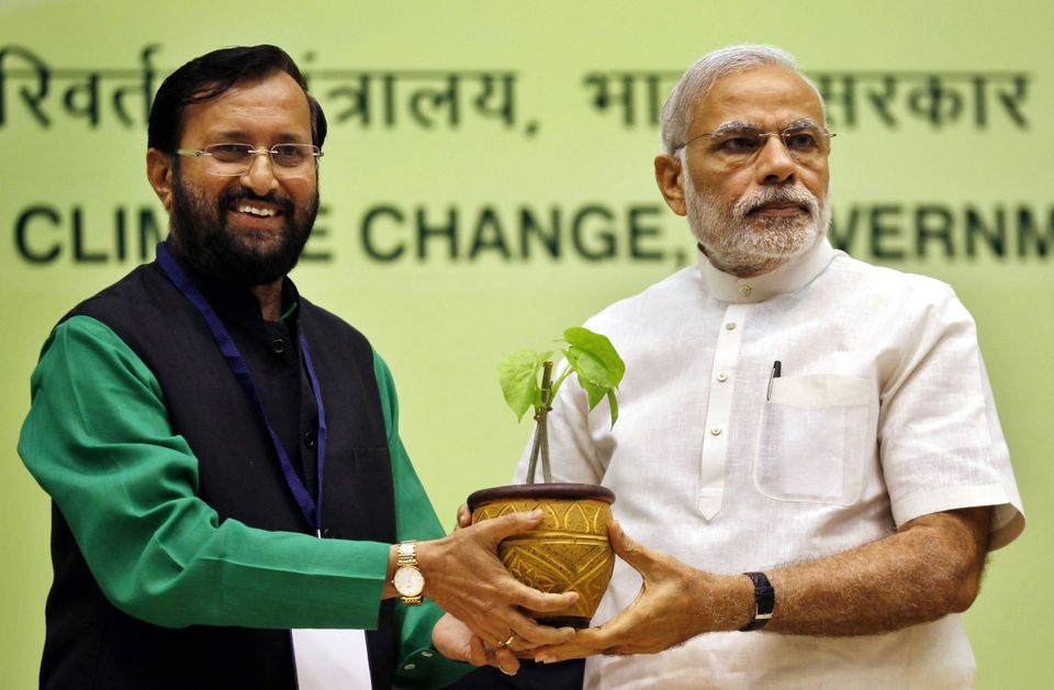 Union Minister for Environment, Forest and Climate Change Prakash Javadekar presents a sapling to Prime...