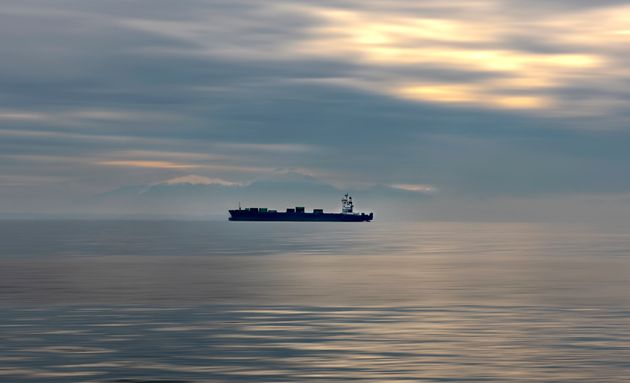 Container ship traveling on Aegean sea.