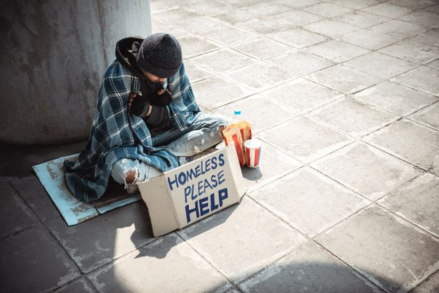 One man, young homeless sitting on the street and