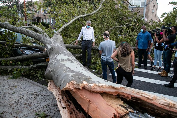 New York City Mayor Bill de Blasio talks with residents about damage from Tropical Storm Isaias, Tuesday, Aug. 4, 2020, in th