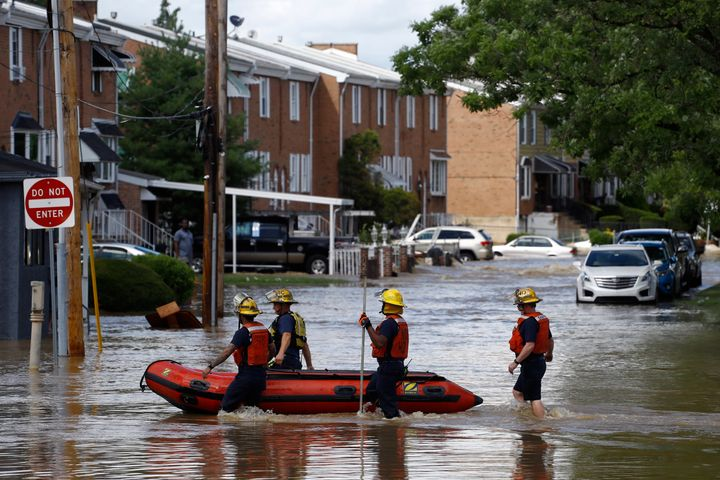 Philadelphia firefighters walk through a flooded neighborhood after Tropical Storm Isaias moved through, Tuesday, Aug. 4, 202