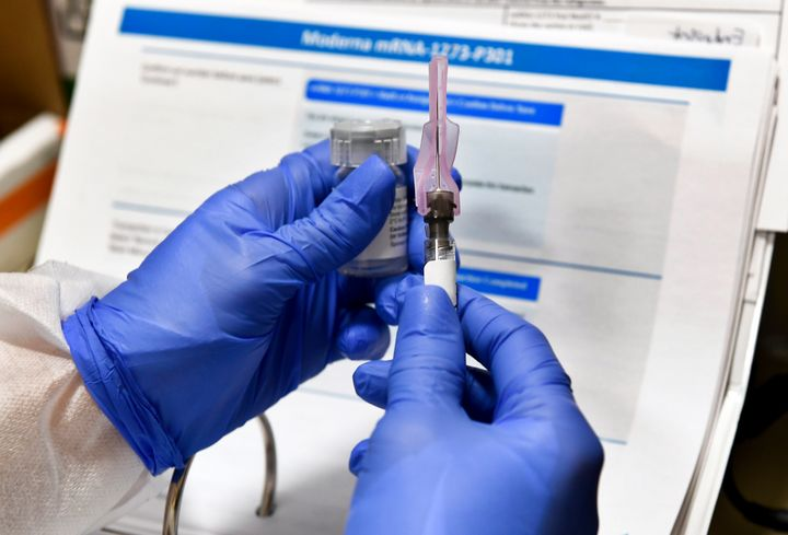 A nurses in New York prepares a shot for a potential COVID-19 vaccine, which is being developed by the U.S. National Institutes of Health and Moderna Inc. In July,both Pfizer and Moderna reported positive results from small coronavirus vaccine trials.