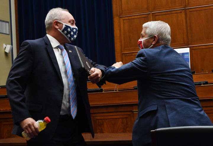 Rep. Steve Scalise (R-La.), left, elbow-bumps Anthony Fauci, director of the National Institute for Allergy and Infectious Di