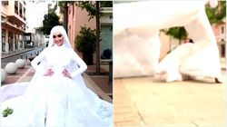 Posa per le fotografie nel giorno delle sue nozze, l'esplosione di Beirut la travolge