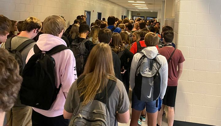 A photo taken Aug. 4, 2020, by a student at North Paulding High School in Dallas, Georgia, shows students crowding hallways w