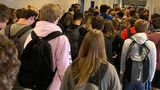 A photo taken Tuesday, August, 4, 2020, by a student at North Paulding High School in Dallas, Georgia, shows that students continue to crowd hallways while fewer than half wear masks. The 30,000-student suburban Paulding County school district in suburban Atlanta resumed classes Monday with 70% of students returning for in-person classes five days a week, days after the principal at North Paulding announced some members of the football team had tested positive for COVID-19. The district says it is encouraging mask use, but isn't requiring it.