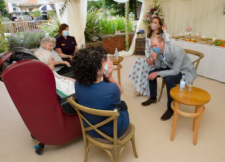 The Duke and Duchess of Cambridge react as they were told they aren't good at online bingo by resident Joan Drew Smith (in wh
