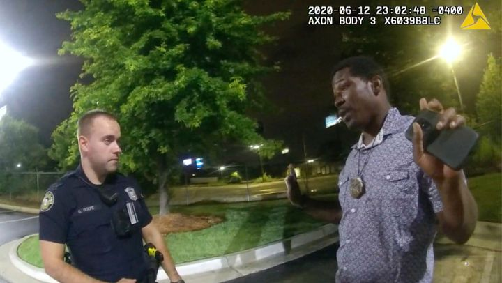 Rayshard Brooks (right) being questioned by Garrett Rolfe (left) outside of a Wendy's in Atlanta on June 12. Shortly thereaft