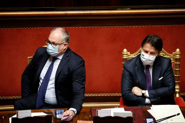The Italian deputy Roberto Gualtieri and the Italian premier Giuseppe Conte, both with surgical mask,...
