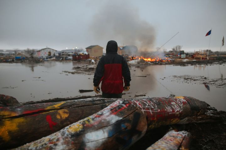 A demonstrator at the encampment opposing the construction of the Dakota Access Pipeline in February 2017 as federal official