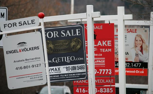 Real estate for sale signs are shown in Oakville, Ont., on Dec. 1, 2018. The Toronto Regional Real...