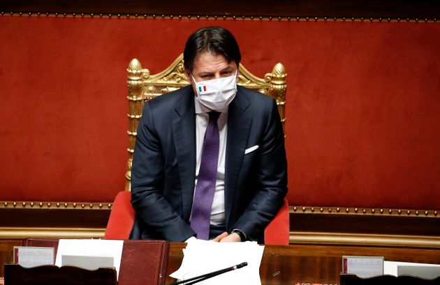 Italian Prime Minister Giuseppe Conte with protective mask in the Senate Chamber during the information...