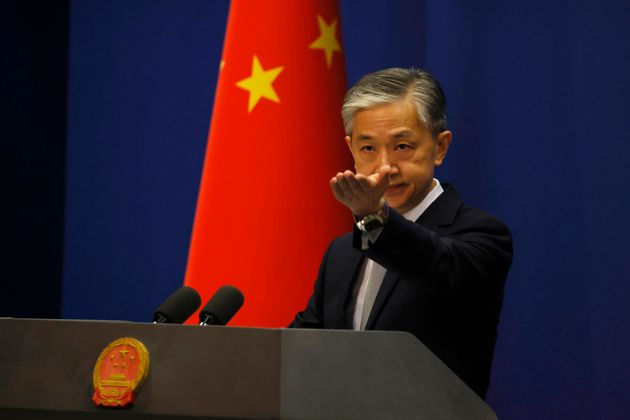 Chinese foreign ministry spokesperson Wang Wenbin, seen here in Beijing in July, said there was no connection...