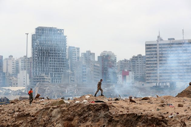 A soldier walks at the devastated site of the explosion in the port of Beirut, Lebanon, Thursday Aug.6,...