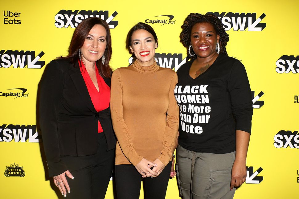 "Cori Bush, right, joins Amy Vilela, left, and Rep. Alexandria Ocasio-Cortez (D-N.Y.) at the premiere of the documentary ""Knoc"