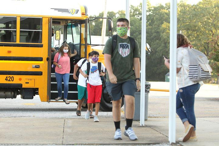 Students wearing masks head to class at Mooreville High School in Mooreville, Mississippi, on Thursday. The high school is no