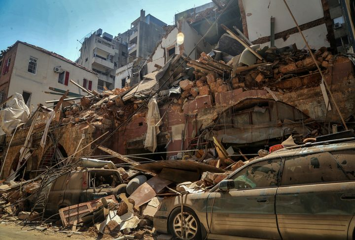 Cars under the rubble of a destroyed house a day after a massive explosion in Beirut's port, killing at least 100 people and injured thousands.