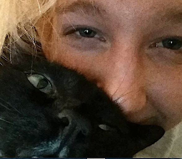 Reality Winner and her cat before her arrest in 2017.