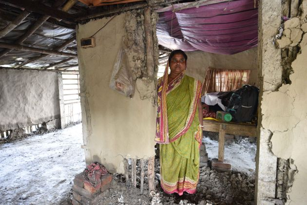 A woman standing in her home damaged due to Cyclone Amphan, at Kakdwip in the Sunderbans, South 24 Parganas...