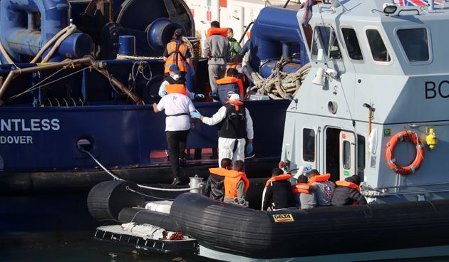 A Border Force vessel brings a group of men thought to be migrants into Dover,
