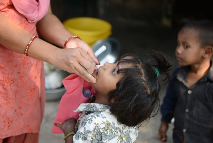 An child receives polio drops from a health worker during a polio immunisation programme in Siliguri on January 30, 2017.&nbs