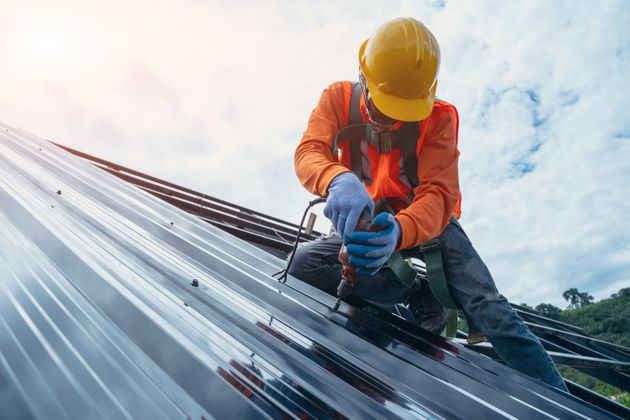 A roofer works on a roof in this undated stock photo. Canada's unemployment rate was 10.9 per cent in...