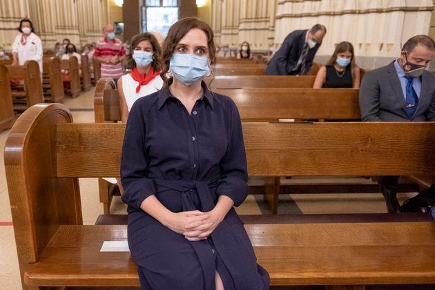 Ayuso, en una misa por los fallecidos durante la