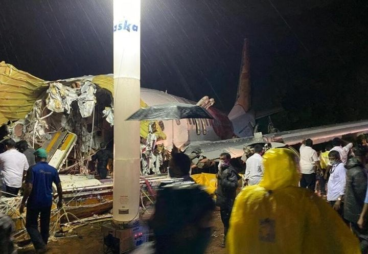 Teams conduct search and rescue operation at the site after an Air India Express passenger plane with 190 passengers onboard skidded off the runway in Kerala on August 7, 2020.