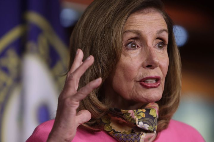 Speaker of the House Nancy Pelosi (D-Calif.) participates in a news conference on Friday. She -- along with Treasury Secretar