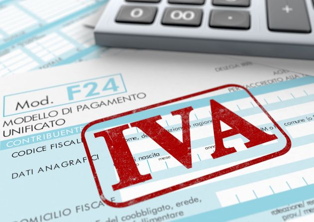 close up view of F24 form for italian taxes,the word iva and an electronic calculator (3d