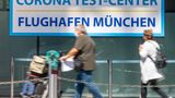 07 August 2020, Bavaria, Munich: Travellers go to the registration of the Corona Test Centre at Munich Airport. Health Minister Huml (CSU) will visit the corona test centre on Friday. Photo: Peter Kneffel/dpa (Photo by Peter Kneffel/picture alliance via Getty Images)