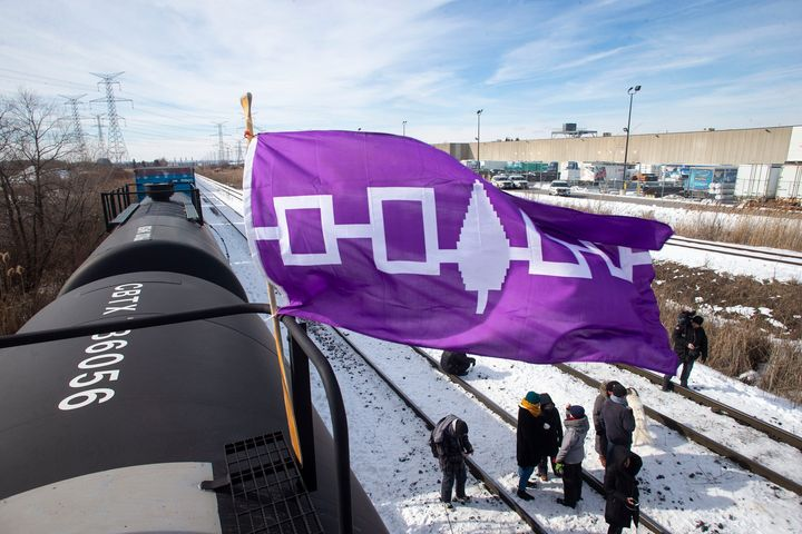 A Haudenosaunee flag, representing the First Nations people also known as the Iroquois or Six Nations, flies from a petroleum car during the blockade of the rail line at Macmillan Yard in Toronto on Feb. 15, 2020.