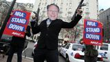 """IMAGE DISTRIBUTED FOR AVAAZ- Members of the activist group Avaaz protest today's NRA press conference with a likeness of NRA CEO Wayne LaPierre Jr., calling on NRA affiliates like Days Inn and Super 8 to get """"out of bed"""" with the gun lobby, outside the Willard Hotel in Washington, Friday, Dec. 21, 2012. (Paul Morigi / AP Images for Avaaz)"""
