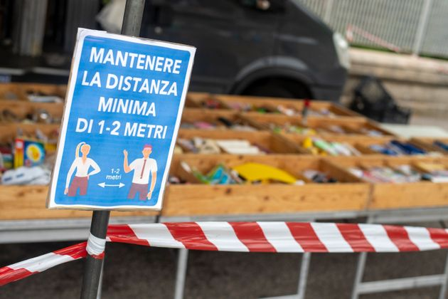 TEMPIO PAUSANIA, ITALY - MAY 16: a sign displayed in a local market indicates to maintain the minimum...